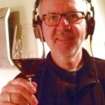 Lauri with a glass of his own red wine Lukase Reserv and his favorite headphones (Sony MDR)
